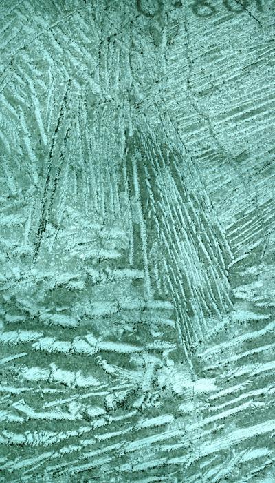 """Micrografía de una komatita. Las placas paralelas que se aprecian dan lugar a lo que se conoce como """"textura spinifex"""". Credit: CSIRO, Australia"""